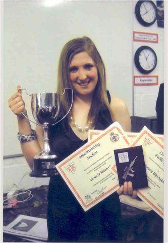 Photo shows Victoria with awards